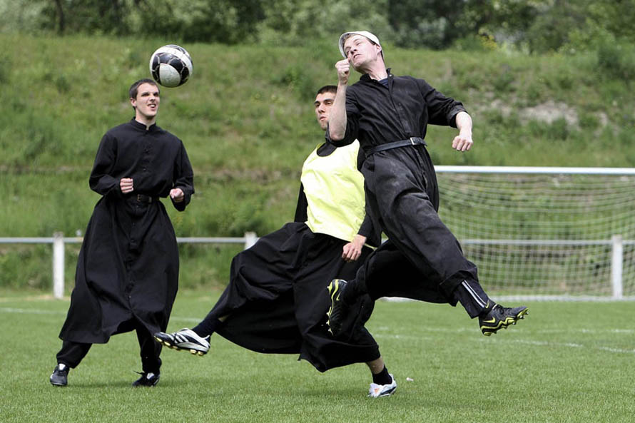 Seminarist from the Seminary of Econe, the International Seminary of Saint Pius X, play soccer in Riddes, Switzerland, Sunday, May 17, 2009. For the majority of the week the priests concentrate on prayers, but Wednesday and Sunday afternoons are reserved for relaxation, when many of the priests from the Seminary of Econe play soccer.   AP Photo/Keystone/Jean-Christophe Bott